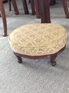 Antique upholstered footstool.