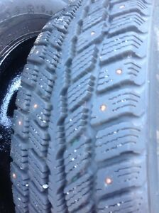 175/70R13 studded tires mounted on rims