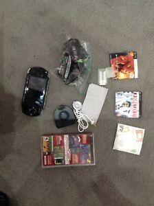 Sony PSP Console, charging cable and games $50