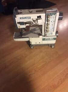 Machine a coudre industrielle coverstitch