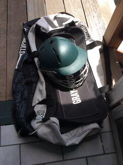 Cricket helmet + A small gray Nicholls carry bag