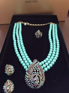 Heidi Daus necklace, pierced earrings and ring