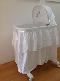 Baby bassinet -with wheels and rocking base.