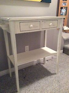 White microwave table with two drawers and towel rack