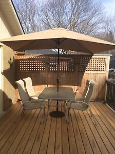 Outdoor dining set with umbrella