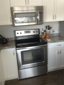 Almost new Range and over the range Microwave