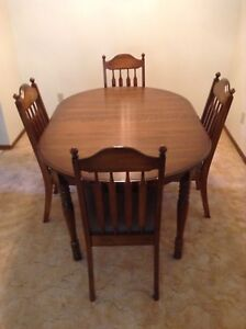 Large dining table with 4 chairs and leaf