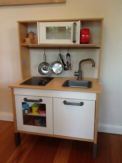 IKEA toy kitchen with food and equipment