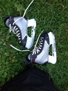 Boys hockey skates /full hockey gear for about an 8 year old