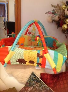 very nice infant play mate with toys for $20 only