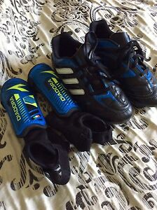 Size 1 Adidas shoes or Size XS shin guards