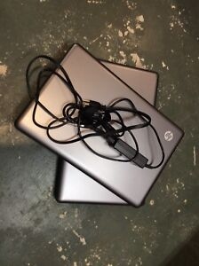 Two  HP 2000 Notebooks, one power cord, with Win 10