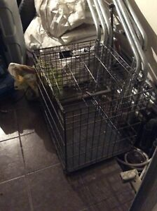 Single door metal dog crate  About 18x21x25 inches