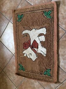 Vintage hooked rug. Dog Scottie.