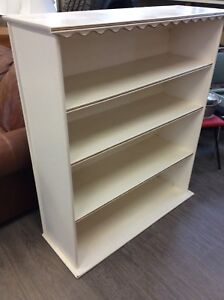 Wooded book shelving unit