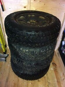 4-p235/70r16 winter studded tires on rims