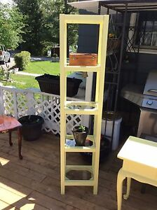 Tall glass shelf unit