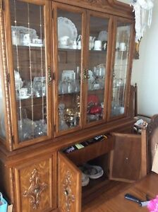 All wood dining table and China Cabinet set.