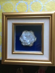 "Hand made flower in frame of 8"" x 8"" $10"