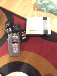 NES nintendo system with 5 games and 2 controllers