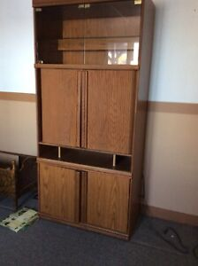Cabinet with lights glass doors on top