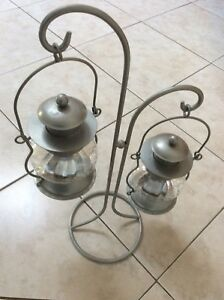candles light holder in silver colour $10