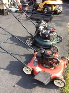 Two lawnmowers for parts