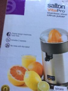 stainless steel citrus juicer in a box $20