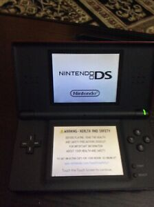 Red Nintendo DS with 9 CD