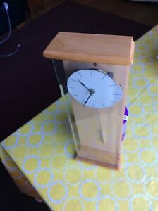 A flat glass cover the entire front of this wall clock $10