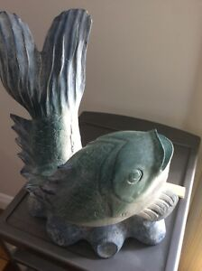Hand carved wood fish figurine in light blue colour for $15
