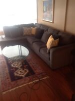 Ashley furniture sectional couch + free glass table included