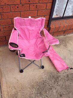 Girls folding picnics chair