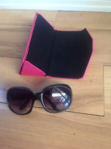 Sunglasses and pink case