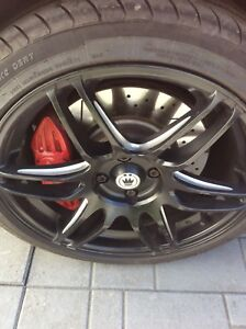 """Black 17"""" rims with performance tires"""