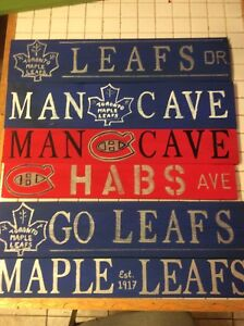 Large variety of solid wood rustic signs