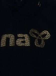 TNA black and gold sweater great condition Google for spring