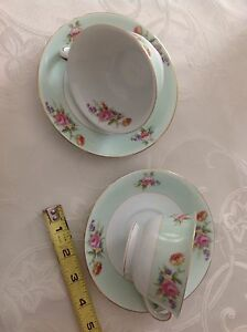 Two bone china tea cups and saucers