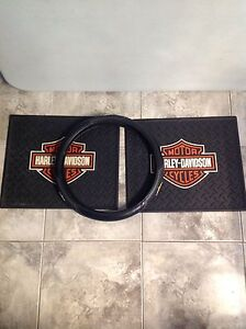 Harley Davidson $35.00 steering wheel cover & 2 floor mats.