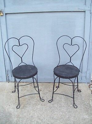 Black heart sweetheart wrought iron adult parlor chairs lot of 2 wood seats  ()