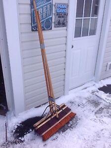 Three push brooms