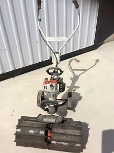 Stihl gas powered lawn sweeper with also rotatilor