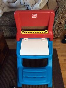 Fisher price drawing table with storage and a painting