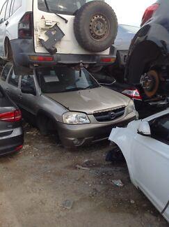 Wrecking Mazda Tribute wagon gold
