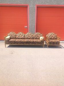 Large antique couch with matching lounge chair