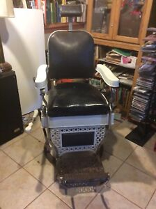 Antique barber chair made by Theo A. Kochs