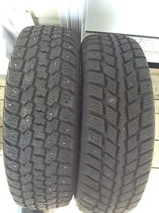Two  195/ 70/ R 14 studded tires