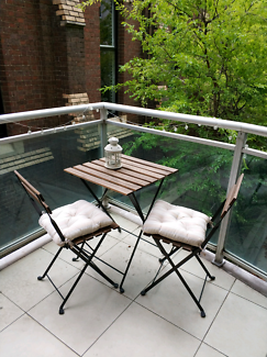 Outdoor table, chair and cushions