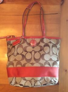 Coach Purse in Iconic Pattern with Orange highlights