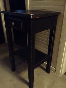 Black distressed end table